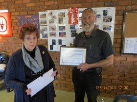 Gert ZR6BV receiving his certificate from Pam ZS6APT